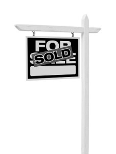 Isolated Sold For Sale Real Estate Sign with Clipping Path.